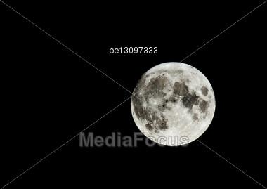 Full Moon In The Sky. Craters Are Visible Stock Photo