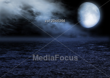 Full Moon In The Night Sky Reflected In Water Stock Photo
