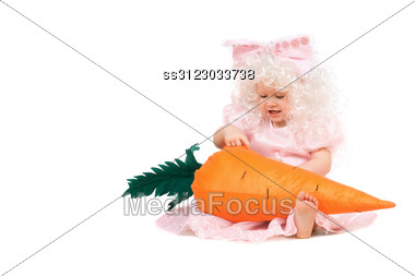 Funny Baby Girl Plays With A Carrot Stock Photo