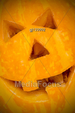 Funny Carved Halloween Pumpkin Background Close-up Stock Photo