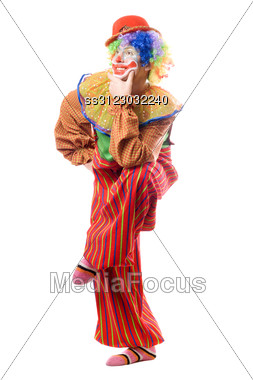 Funny Clown Standing On One Leg. Stock Photo