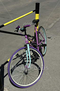 Funny Colored Bike Parked At Street At Sunny Summer Day Stock Photo