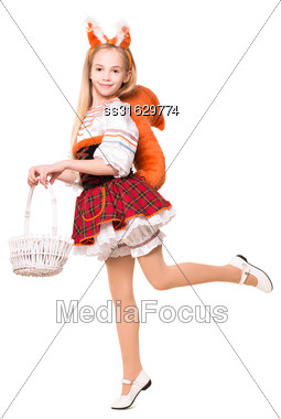 Funny Little Girl Posing In A Squirrel Costume With Basket. Isolated On White Stock Photo