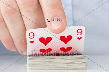 Gamble Concept . Player Hand Revealing Nine Of Hearts Stock Photo