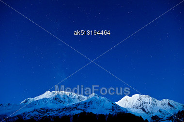 Gangapurna And Annapurna Mountains On The Blue Sky With Stars, Himalaya, Nepal Stock Photo