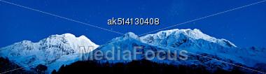 Gangapurna And Annapurna Mountains On The Blue Sky With Stars, Himalaya, Nepal Stock Photo
