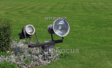 Garden Lighting And Green Grass In Daylight Stock Photo