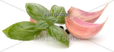 Garlic Clove And Basil Leaf Isolated On White Background Stock Photo