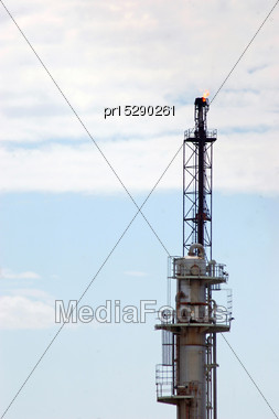 Gas Burning Off On Refractory Tower At Oil Refinery Stock Photo
