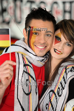 German Football Fans Watching The Game On Television Stock Photo