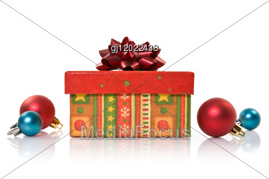 Gift Box And Christmas Baubles Stock Photo