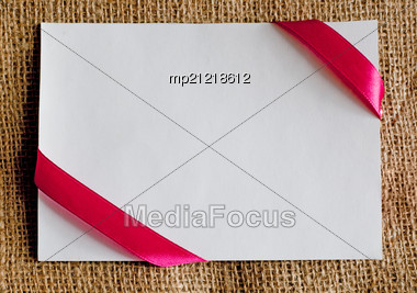 Gift Card With Ribbon On Canvas Textile Stock Photo