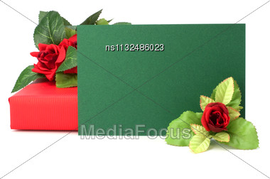 Gift With Floral Decor. Flowers Are Artificial Stock Photo