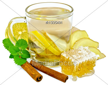 Ginger Tea With Lemon In A Glass Mug, Mint, Cinnamon, Ginger Root, Honeycomb Isolated On White Background Stock Photo