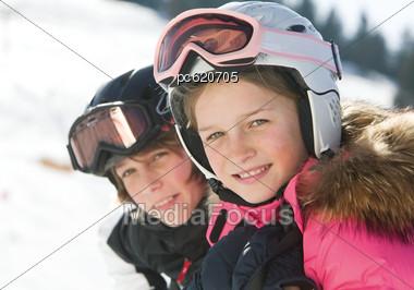Girl And Boy Skiing, Portrait Stock Photo