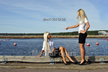 Girl Arguing With Another Girl On The Pier Stock Photo