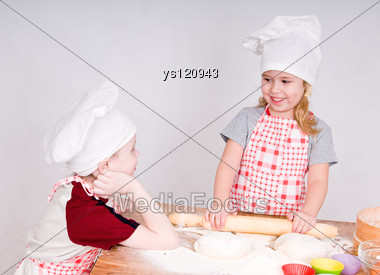 Girl And Boy Say And Prepare Meal Stock Photo