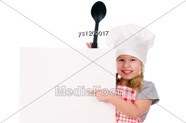 Girl In Chef's Hat Indicates On Blank Sheet Stock Photo
