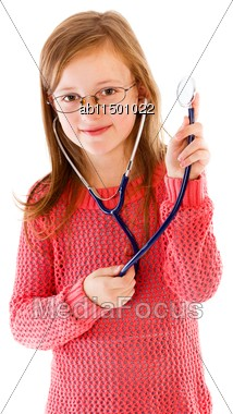Girl child with desire to become  a doctor playing with stethoscope. Stock Photo