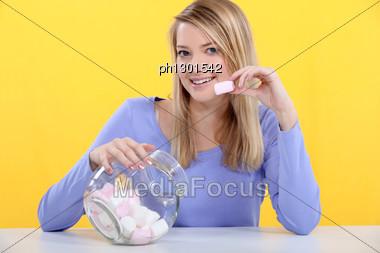 Girl Eating Marshmallows Stock Photo