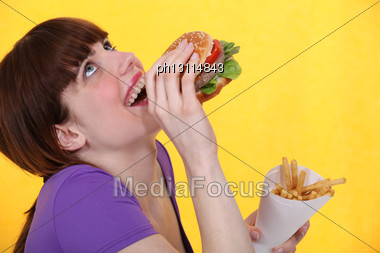 Girl Ecstatic Over Hamburger Meal With Fries Stock Photo