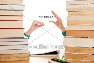 Girl Got Bored Of Studying, Plays With Her Hands Stock Photo