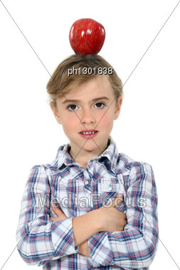 Girl Having An Apple On Her Head Stock Photo