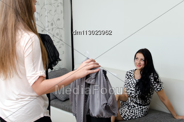 Girl Helps Her Friend Choose The Dress Stock Photo