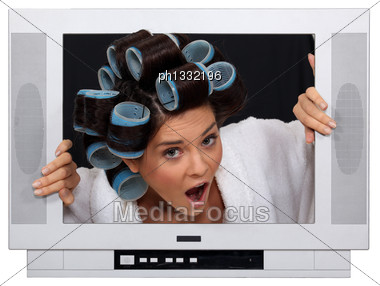 Girl In TV Screen With Hair Curlers Stock Photo