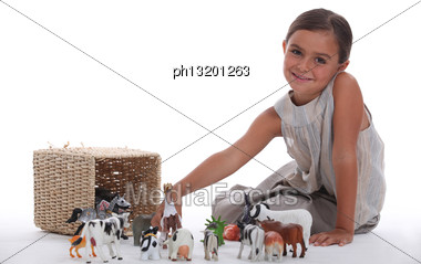 Girl Playing With Toy Animals Stock Photo