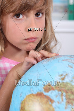 Girl Pointing At Globe Stock Photo