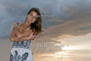Girl Poses Against The Sky Stock Photo