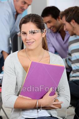 Girl Posing In A Classroom Stock Photo