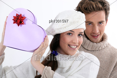 Girl Showing A Heartshaped Box Stock Photo
