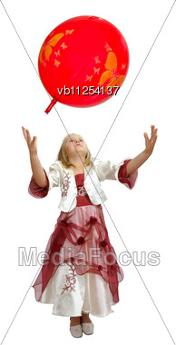 Girl In A Smart Dress Plays With A Red Balloon Stock Photo