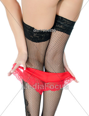Girl In Stockings Taking Off Her Red Panties. Close Up View. Isolated On White Stock Photo