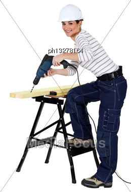 Girl Using Drill Stock Photo