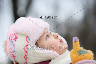 Girl In Winter Clothes, Watch And Shows Up Stock Photo