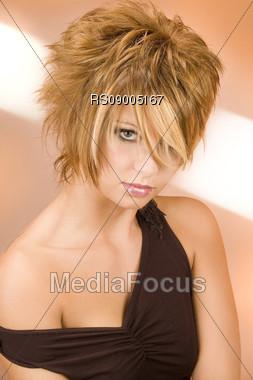 Girl with modern hairstyle orange background Stock Photo