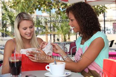 Girlfriends On A Weekend Shopping Trip Stock Photo