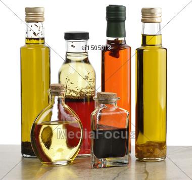 Glass Bottles Of Olive Oil,Salad Dressing And Vinegar Stock Photo