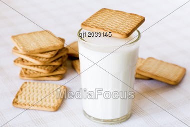 Glass Of Fresh Milk And Cookies On The Table Stock Photo
