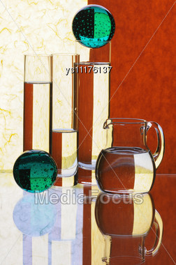 Glass Glasses And Jug On A Multi-coloured Background Stock Photo