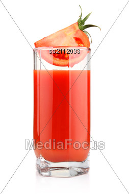 Glass Of Tomato Juice And Fruits With Green Leaves Stock Photo
