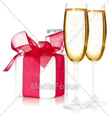 Glasses Of Champagne And A Gift Box On White Background Stock Photo