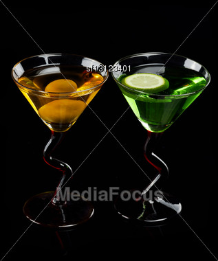 Glasses Of Cocktail Drinks On Black Background Stock Photo