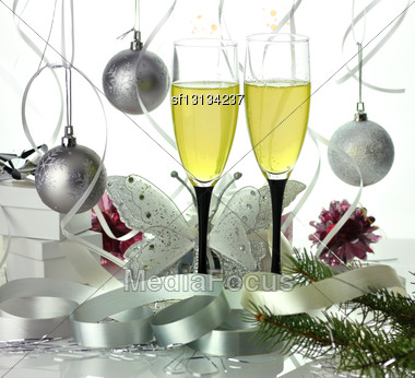 Glasses Of Champagne With Christmas Decorations Stock Photo