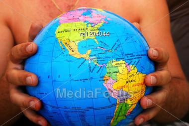 Globe In Man Hands. Stock Photo