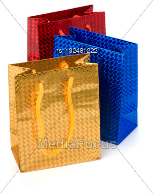 Glossy Festive Gift Bags Isolated On White Background Stock Photo