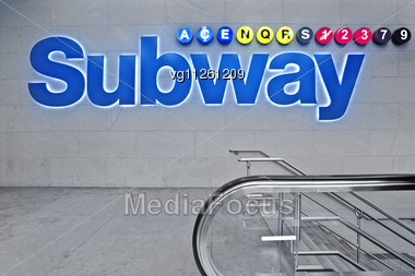 Glowing Blue Subway Station Sign And Downstairs, Lines Info Display Stock Photo